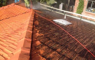 Pressure cleaning on clay roof before and after